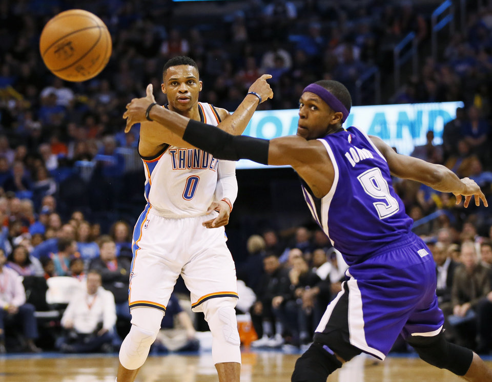 Photo - Oklahoma City's Russell Westbrook (0) passes around Sacramento's Rajon Rondo (9) during an NBA basketball game between the Oklahoma City Thunder and the Sacramento Kings at Chesapeake Energy Arena in Oklahoma City, Monday, Jan. 4, 2016. Photo by Nate Billings, The Oklahoman