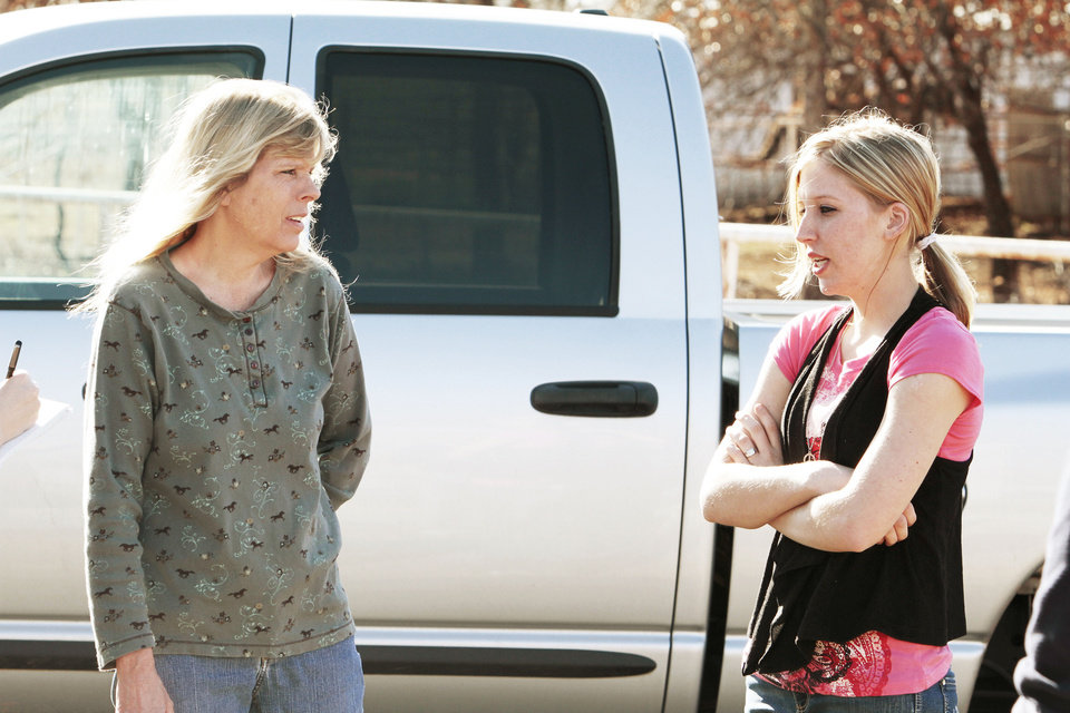 Photo - Sarah McKinley, 18, right, talks with her mother, Debbie Murray, on Wednesday outside her rural home in Blanchard. McKinley shot and killed an intruder who broke through the front door.