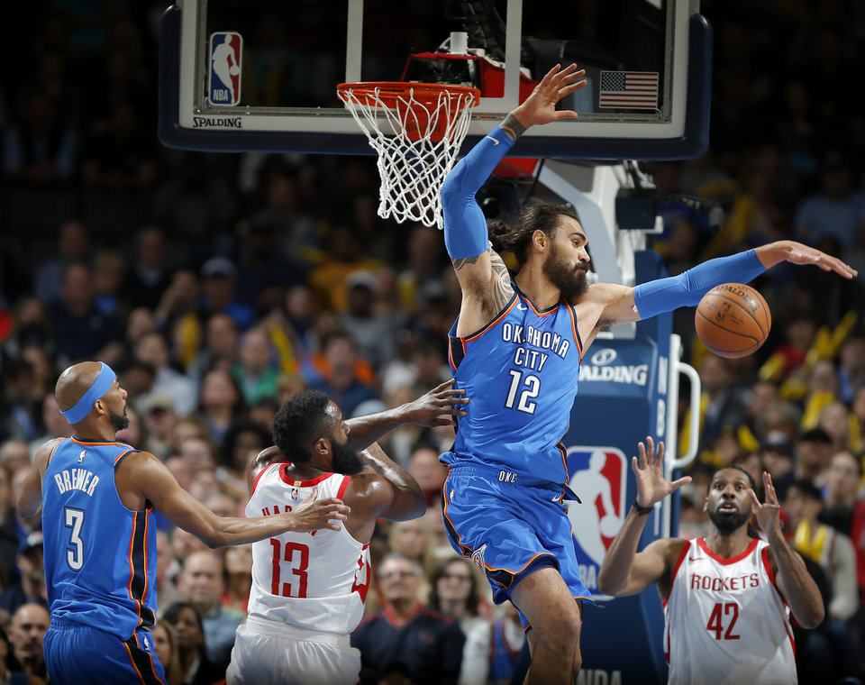 Photo - Oklahoma City's Corey Brewer (3) and Steven Adams (12) go for the ball beside Houston's James Harden (13) during an NBA basketball game between the Oklahoma City Thunder and the Houston Rockets at Chesapeake Energy Arena in Oklahoma City, Tuesday, March 6, 2018.  Photo by Bryan Terry, The Oklahoman
