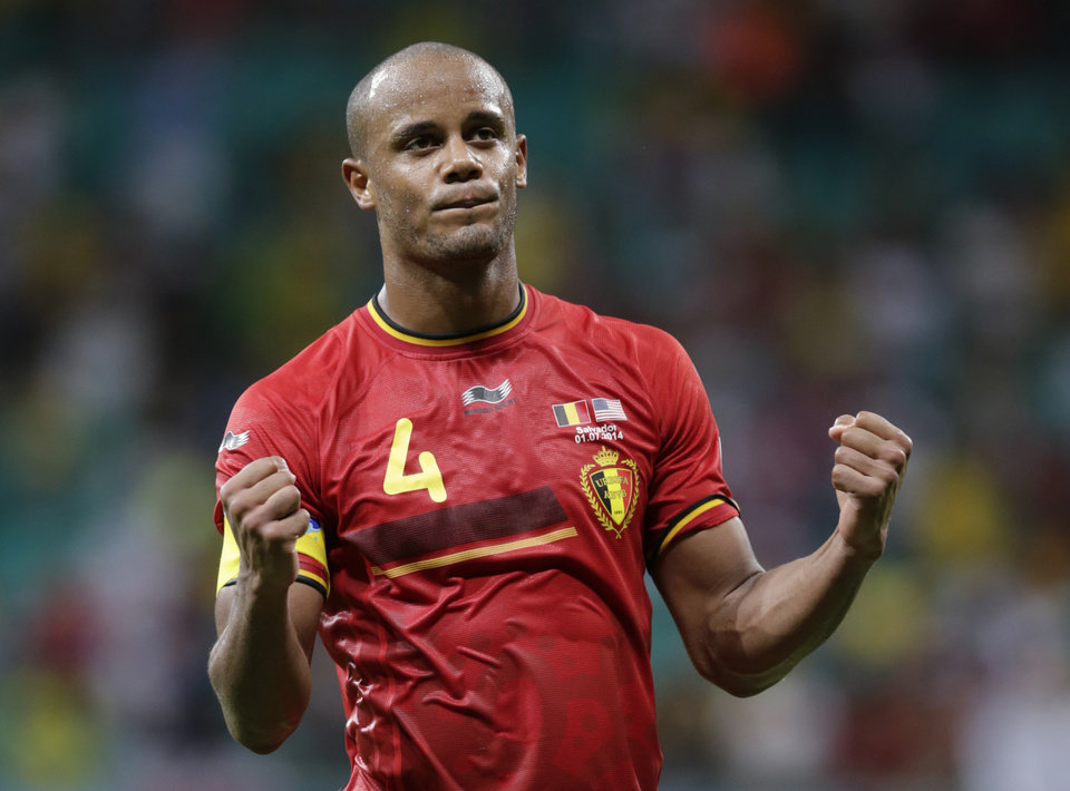 Photo - Belgium's Vincent Kompany celebrates after the World Cup round of 16 soccer match between Belgium and the USA at the Arena Fonte Nova in Salvador, Brazil, Tuesday, July 1, 2014. Belgium won the match 2-1 after extra-time. (AP Photo/Julio Cortez)
