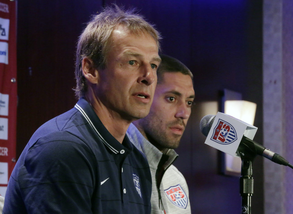 Photo - United States World Cup soccer team coach Jurgen Klinsmann, left, and team captain Clint Dempsey answer questions  during a news conference, in New York, Friday, May 30, 2014.(AP Photo/Richard Drew)