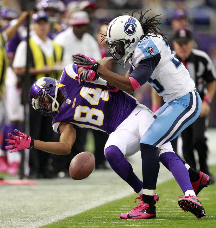 Photo -   Tennessee Titans safety Michael Griffin, right, breaks up a pass intended for Minnesota Vikings wide receiver Michael Jenkins (84) during the first half of an NFL football game on Sunday, Oct. 7, 2012, in Minneapolis. (AP Photo/Genevieve Ross)