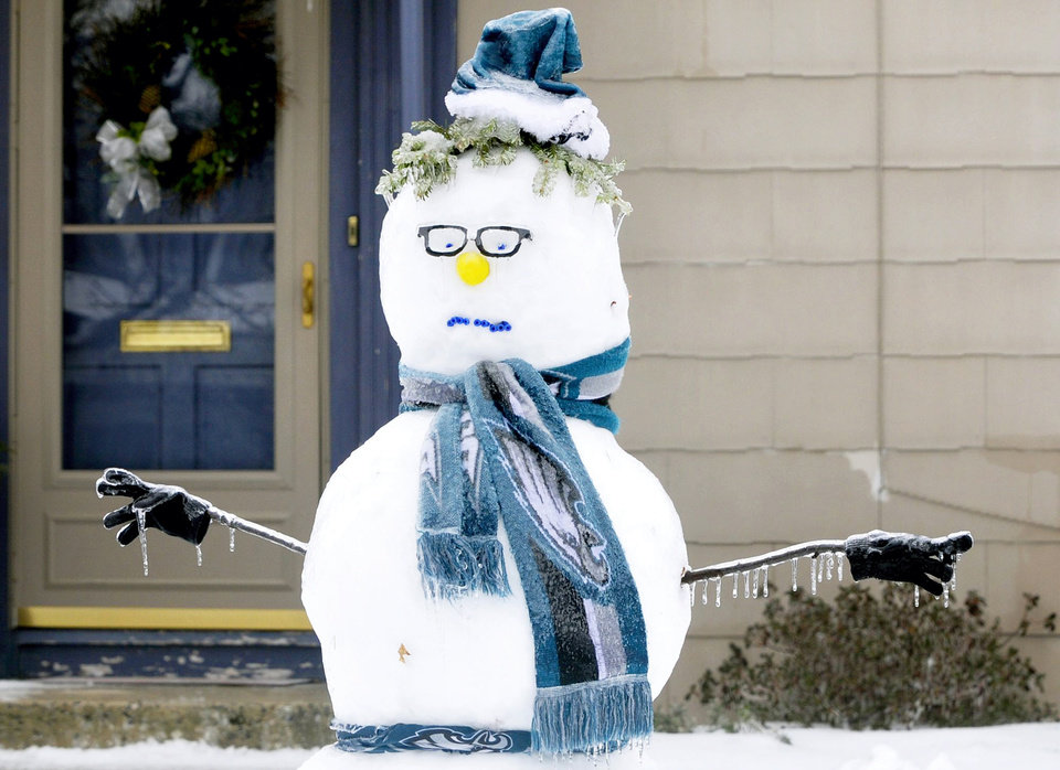 Photo - Icicles hang from a snowman's arms Wednesday, Feb 5, 2014, in Chambersburg, Pa. (AP Photo/Public Opinion, Markell DeLoatch)