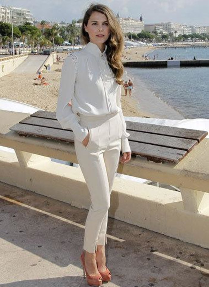 Russell posed during the photo call for her new series at the annual MIPCOM television content market in Cannes, France, wearing crisp white and cool vanilla. She chose a high-collar white blouse with lace insets, creamy cropped slacks and peach peep-toe pumps. It was an outfit befitting the wind-swept beach city.