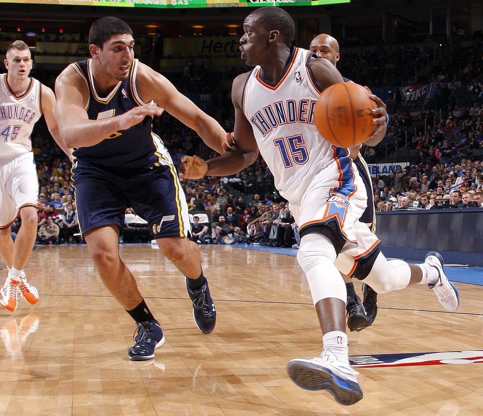 Photo - Oklahoma City's Reggie Jackson (15) goes past Utah's Enes Kanter (0)during an NBA game between the Oklahoma City Thunder and the Utah Jazz at Chesapeake Energy Arena in Oklahoma CIty, Tuesday, Feb. 14, 2012. Photo by Bryan Terry, The Oklahoman