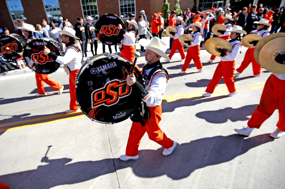 Photo - The Oklahoma State marching band entertains fans at the walk before the college football game between the Oklahoma State University Cowboys and the TCU Horned Frogs at Boone Pickens Stadium in Stillwater, Okla.,  Saturday, Nov. 2, 2019. [Sarah Phipps/The Oklahoman]