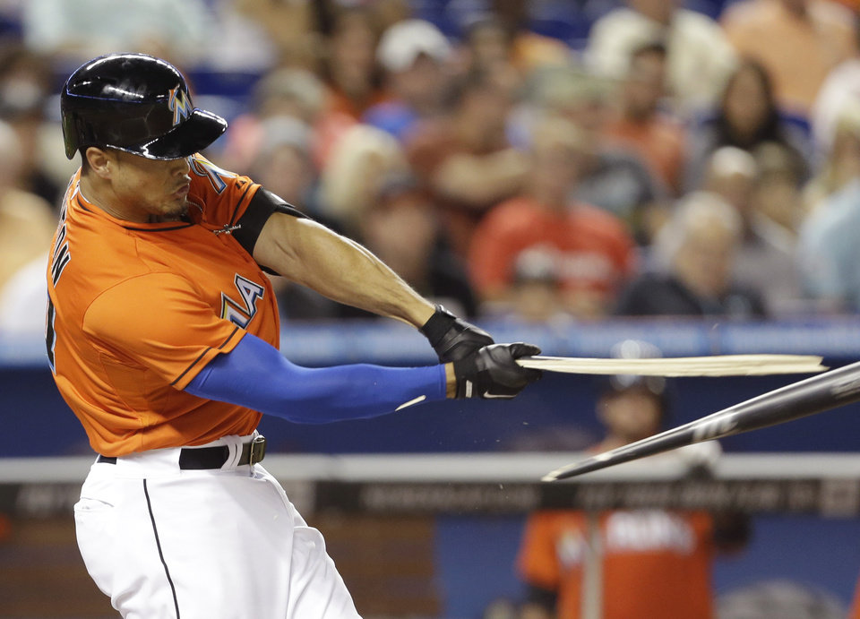Photo - Miami Marlins right fielder Giancarlo Stanton breaks his bat while batting during the fourth inning of an opening day baseball game, Monday, March 31, 2014, in Miami. (AP Photo/Lynne Sladky)