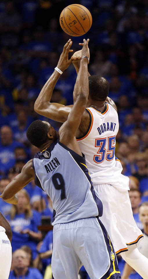 Photo - Memphis' Tony Allen (9) blocks the shot of Oklahoma City's Kevin Durant (35) in the fourth quarter during Game 2 in the first round of the NBA playoffs between the Oklahoma City Thunder and the Memphis Grizzlies at Chesapeake Energy Arena in Oklahoma City, Monday, April 21, 2014. Memphis won 111-105 in overtime. Photo by Nate Billings, The Oklahoman