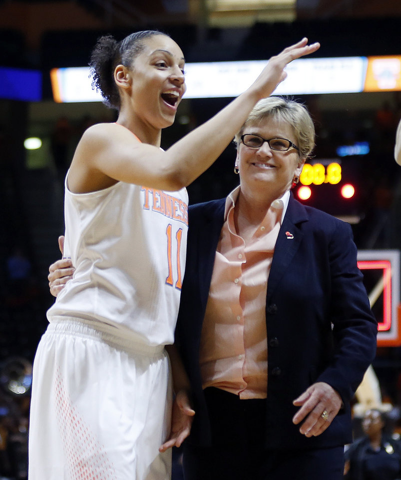 Photo - Tennessee head coach Holly Warlick leaves the court with forward Cierra Burdick (11) after an NCAA women's college basketball second-round tournament game against St. John's Monday, March 24, 2014, in Knoxville, Tenn. Burdick led Tennessee with 21 points as they won 67-51. (AP Photo/John Bazemore)