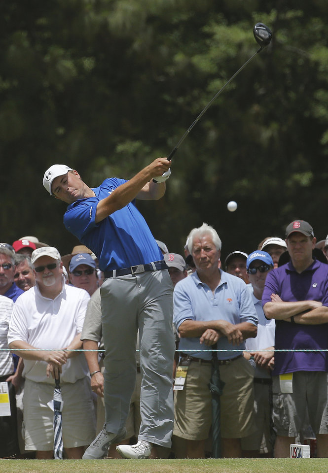 Photo - Jordan Spieth watches his tee shot on the seventh hole during the first round of the U.S. Open golf tournament in Pinehurst, N.C., Thursday, June 12, 2014. (AP Photo/Matt York)