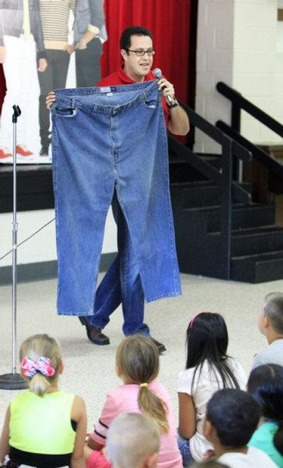 Jared Fogle, Subway spokesman, holding up a pair of size 60 inch waist jeans he used to wear while speaking to students about exercising and making healthy eating choices at Soldier Creek Elementary School in Midwest City Friday, August 13, 2010. Photo by Paul B. Southerland, The Oklahoman ORG XMIT: KOD