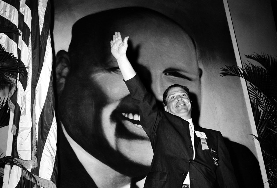 Photo - FILE - In this Sept. 30, 1957 file photo, Jimmy Hoffa, Teamsters vice president and leading candidate to succeed Dave Beck as the IBT's new president, waves to delegates at the opening of the Teamsters Union convention at Miami Beach, Fla. Hoffa's mysterious disappearance, assumed death and myriad searches for his body have been the stuff of urban legends for more than three decades and continue with the most recent report that the former Teamsters chief's remains are buried beneath a concrete slab in a barn in a field in suburban Detroit. (AP Photo/File)