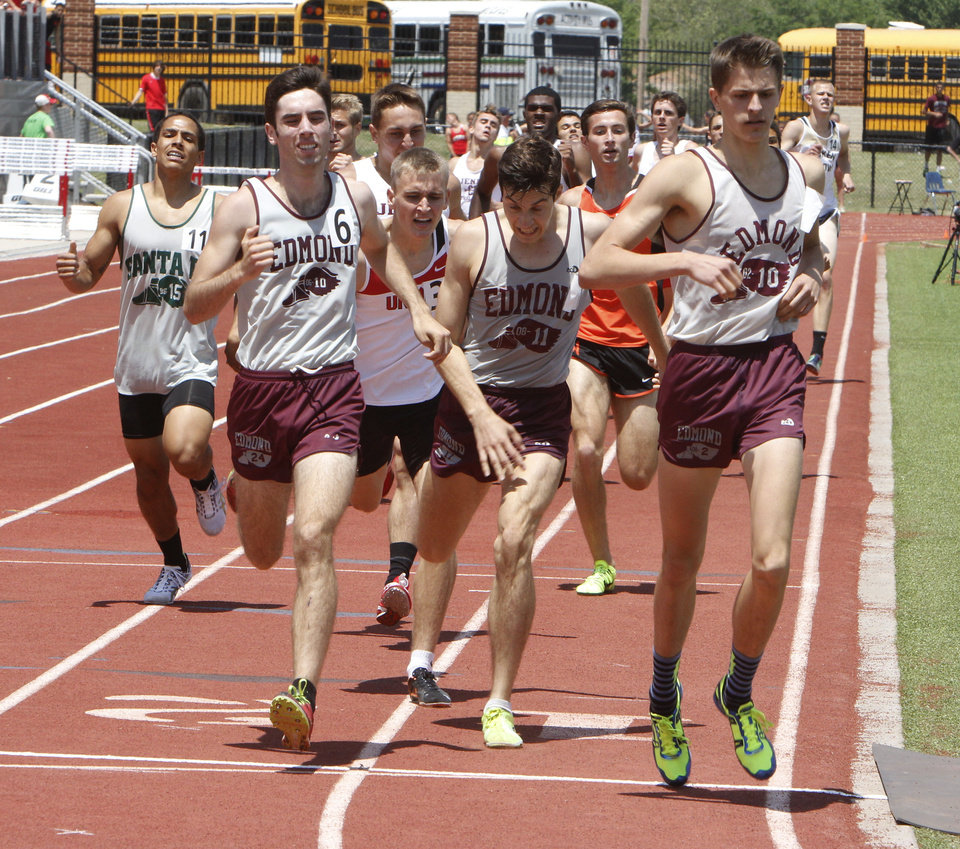Edmond Memorial sweeps the top three slots of the 6A 800 meter race of the 5A and 6A State Track Meet in Yukon, OK, Saturday, May 11, 2013. From left are Ryan Nielson, 2nd, Alex Shook, 3rd, and Grey Howard, 1st place.  By Paul Hellstern, The Oklahoman