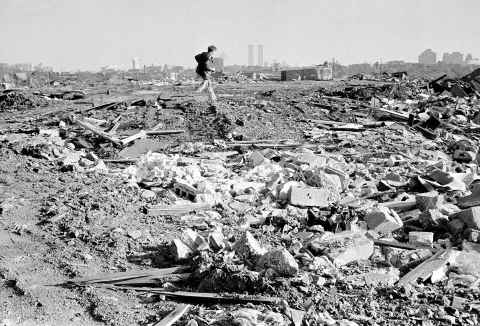 Photo -   FILE - In this Dec. 5, 1975, file photo, a man walks over a rubble field in Jersey City, N.J., one of the locations where authorities searched for the body of missing former Teamster boss Jimmy Hoffa. (AP Photo, File)