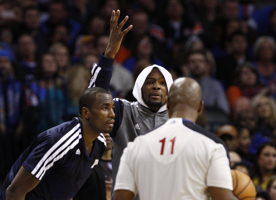 Photo - Oklahoma City Thunder's Kevin Durant (35) reacts to an official's call against his team during the second quarter of an NBA basketball game against the Golden State Warriors on Friday, Jan. 17, 2014, in Oklahoma City. (AP Photo/Alonzo Adams)
