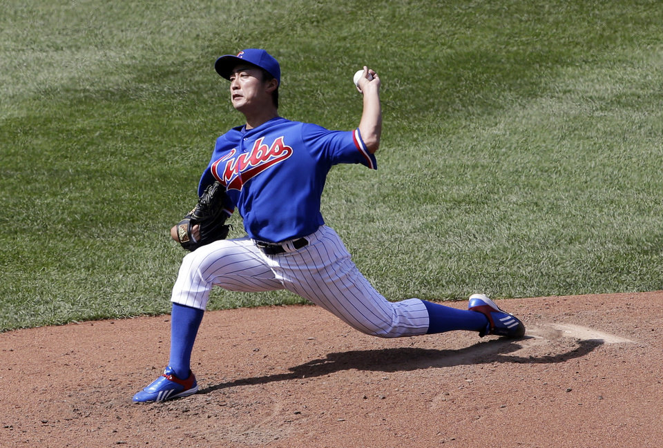 Photo - Chicago Cubs starter Tsuyoshi Wada, of Japan, throws against the Baltimore Orioles during the sixth inning of an interleague baseball game in Chicago, Sunday, Aug. 24, 2014. (AP Photo/Nam Y. Huh)