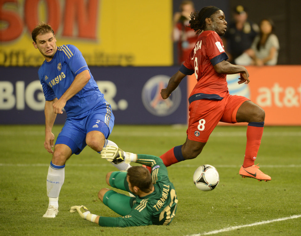Photo -   Paris Saint-Germain's Peguy Luyindula, right, runs past Chelsea FC's Branislav Ivanovic, left, and Chelsea FC goalie Ross Turnbull during the second half of their soccer match at Yankee Stadium in New York, Sunday, July 22, 2012. The game ended in a 1-1 draw. (AP Photo/Henny Ray Abrams)