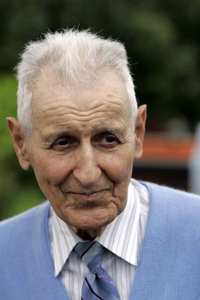 Photo - Assisted suicide advocate Jack Kevorkian walks out of the Lakeland Correctional Facility in Coldwater, Mich., Friday, June 1, 2007.  Kevorkian, the retired pathologist dubbed