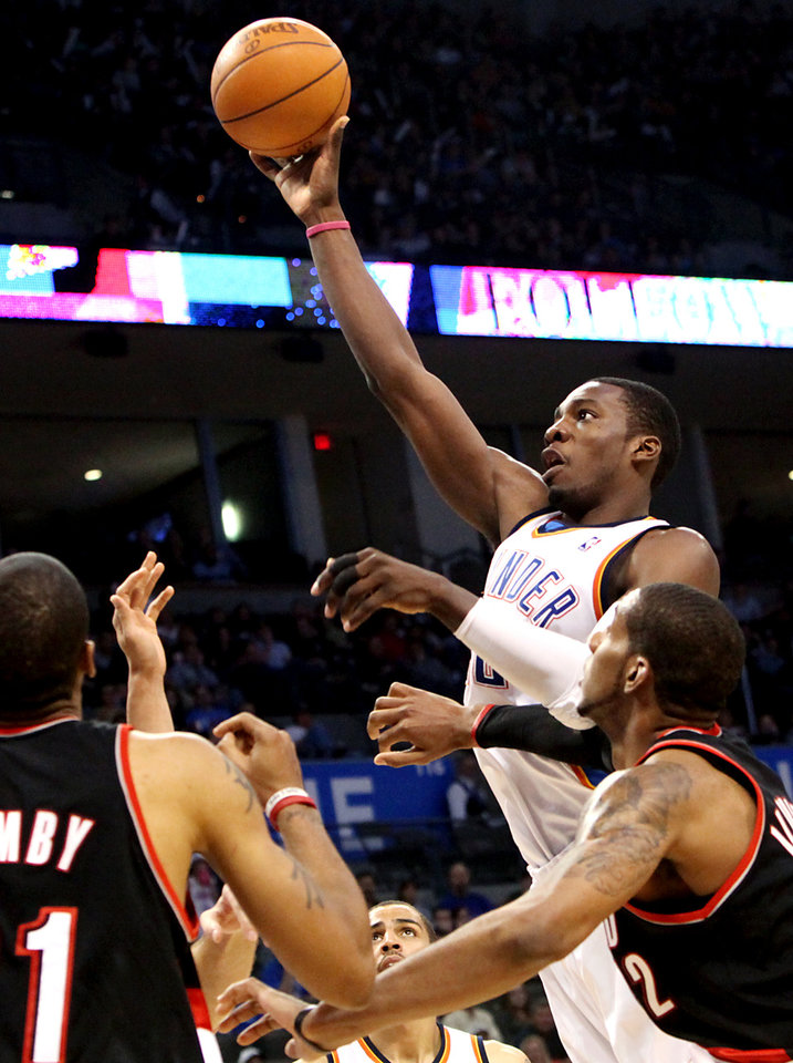 Oklahoma City\'s Jeff Green puts up a shot in front of Portland\'s defense during the second half of their NBA basketball game at the Ford Center in Oklahoma City, Okla., on Sunday, March 28, 2010. The Thunder lost to the Trail Blazers. Photo by John Clanton, The Oklahoman