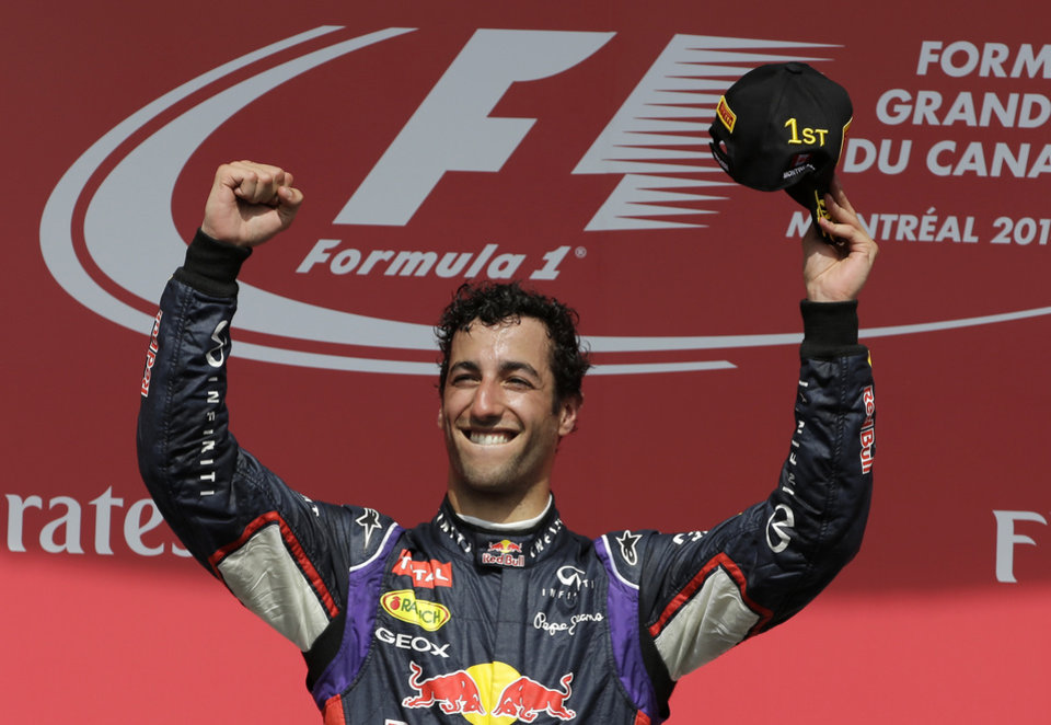 Photo - Red Bull driver Daniel Ricciardo, from Australia, celebrates after winning the Canadian Grand Prix Sunday, June 8, 2014, in Montreal. (AP Photo/David J. Phillip)