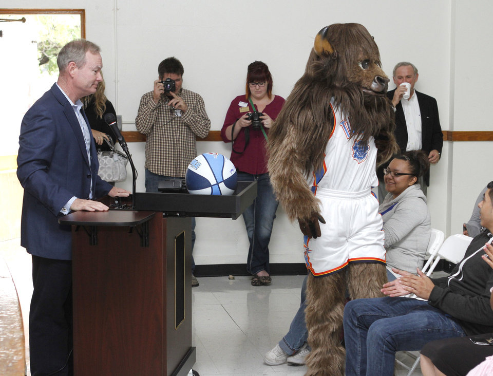 Thunder mascot Rumble and Oklahoma City Mayor Mick Cornett participate in a school assembly celebrating the MAPS for Kids renovation of Emerson High School on Friday.