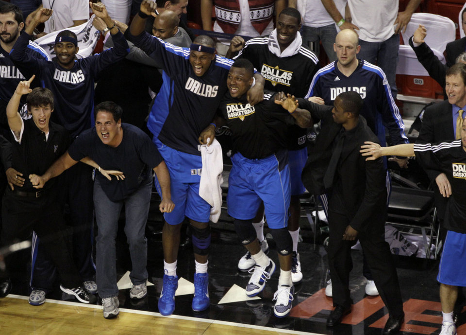 Dallas Mavericks owner Mark Cuban celebrates with the bench during the final seconds of the second half of Game 6 of the NBA Finals basketball game Sunday, June 12, 2011, in Miami. The Mavericks won 105-95 to win the series. (AP Photo/Mark Humphrey)  ORG XMIT: AAA192