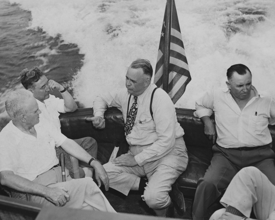 ROBERT S. KERR / OKLAHOMA CITY, OKLAHOMA / GOVERNOR:  Governor Robert S. Kerr with T. Elmer Harpour (Planning & Resources Committee, Muskogee), Joe Croon (Okmulgee Editor), E. W. Humburg, talks Democratic Party and great engineering feat of lake.  Staff photo by Robin Broun.  Photo dated 08/12/1946 and unpublished.  Photo arrived in library 08/26/1946.