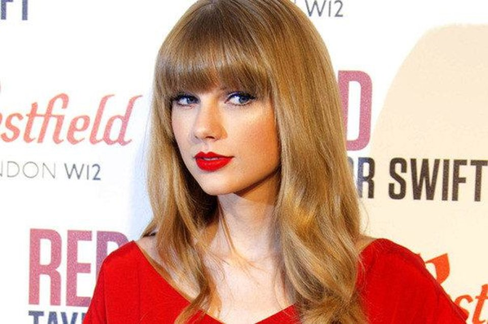 Taylor Swift wears red lipstick often. It's a color that works well for most women regardless of age.  AP Photo. <strong></strong>
