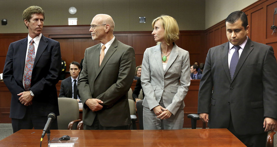 At the moment the verdict is read, George Zimmerman, right, looks down as his defense co-counsel, Don West, second from left, and Lorna Truett, look at Zimmerman\'s lead defense attorney Mark O\'Mara, left, as the verdict is announced in Seminole Circuit Court in Sanford, Fla. on Saturday, July 13, 2013. Jurors found Zimmerman not guilty of second-degree murder in the fatal shooting of 17-year-old Trayvon Martin in Sanford, Fla. (AP Photo/Joe Burbank, Pool) ORG XMIT: FLJR409