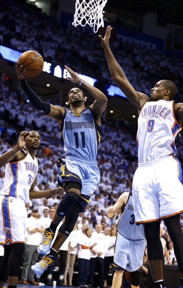 Photo - Oklahoma City's Jeremy Lamb (11) shoots a lay up as Oklahoma City's Serge Ibaka (9) defends during Game 5 in the first round of the NBA playoffs between the Oklahoma City Thunder and the Memphis Grizzlies at Chesapeake Energy Arena in Oklahoma City, Tuesday, April 29, 2014. Photo by Sarah Phipps, The Oklahoman