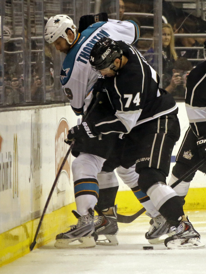 Photo - Los Angeles Kings center Dwight King (74) and San Jose Sharks center Joe Thornton in the second period of an NHL hockey game in Los Angeles Saturday, April 27, 2013. (AP Photo/Reed Saxon)