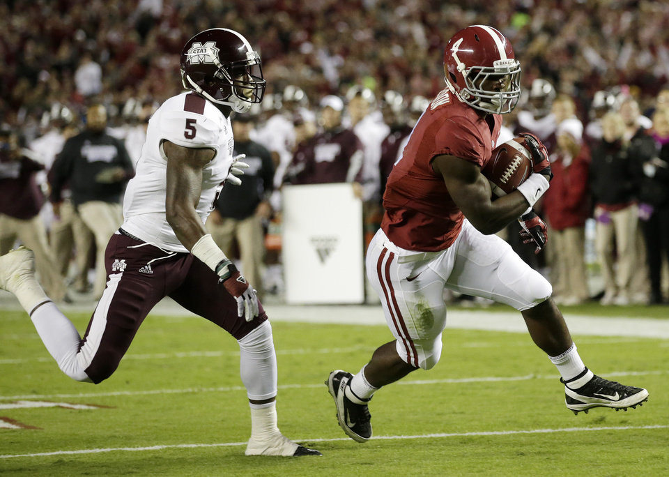 Photo -   Alabama running back T.J. Yeldon (4) scores a touchdown as Mississippi State defensive back Nickoe Whitley (5) pursues during the first half of an NCAA college football game at Bryant-Denny Stadium in Tuscaloosa, Ala., Saturday, Oct. 27, 2012. (AP Photo/Dave Martin)