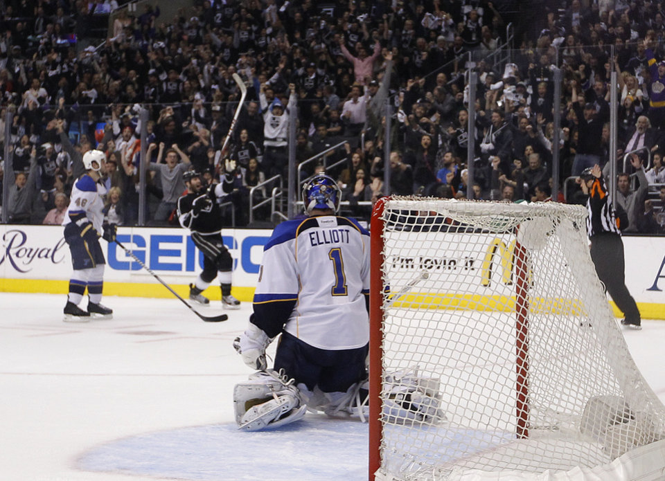 Photo - St. Louis Blues goalie Brian Elliott, center, watches Los Angeles Kings' Dustin Penner, background center, celebrate his goal during the second period in Game 6 of a first-round NHL hockey Stanley Cup playoff series in Los Angeles, Friday, May 10, 2013. (AP Photo/Jae C. Hong)