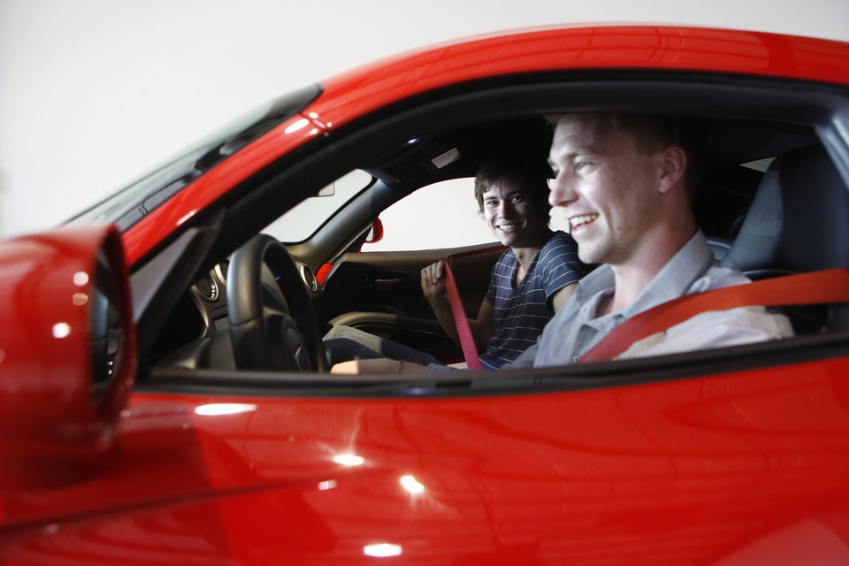 Photo - In this Wednesday, March, 26, 2014 photo, Douglas Sawyer, 23, right, and Michael Clark, 22, left, both from Chicago rent a 2013 Dodge Viper at the Enterprise Exotic Car Collection showroom near Los Angeles International Airport. (AP Photo/Damian Dovarganes)