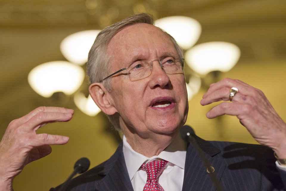 Photo - Senate majority leader Harry Reid gestures as he speaks to the media as lawmakers moved toward resolving their feud over filibusters of White House appointees on Capitol Hill in Washington, Tuesday, July 16, 2013. (AP Photo/Jacquelyn Martin)