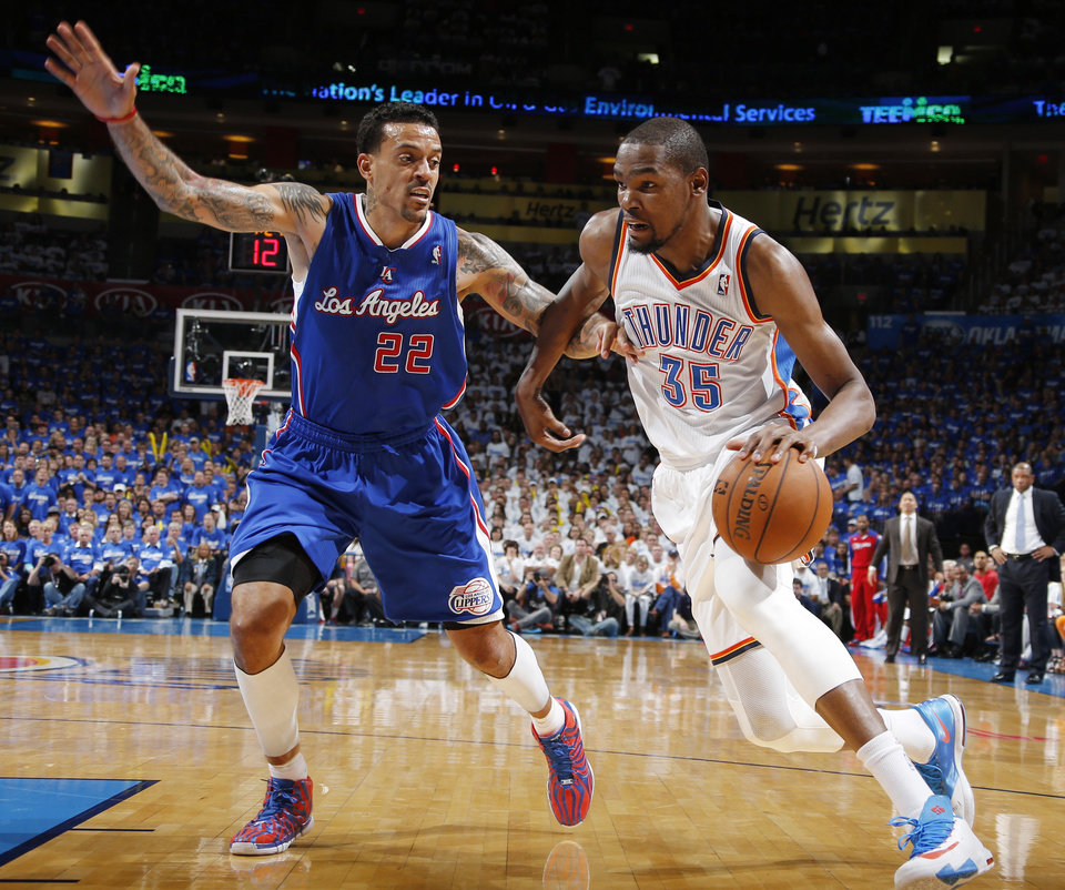 Photo - Kevin Durant (35) drives past Matt Barnes (22) during Game 2 of the Western Conference semifinals in the NBA playoffs between the Oklahoma City Thunder and the Los Angeles Clippers at Chesapeake Energy Arena in Oklahoma City, Wednesday, May 7, 2014. Photo by Bryan Terry, The Oklahoman