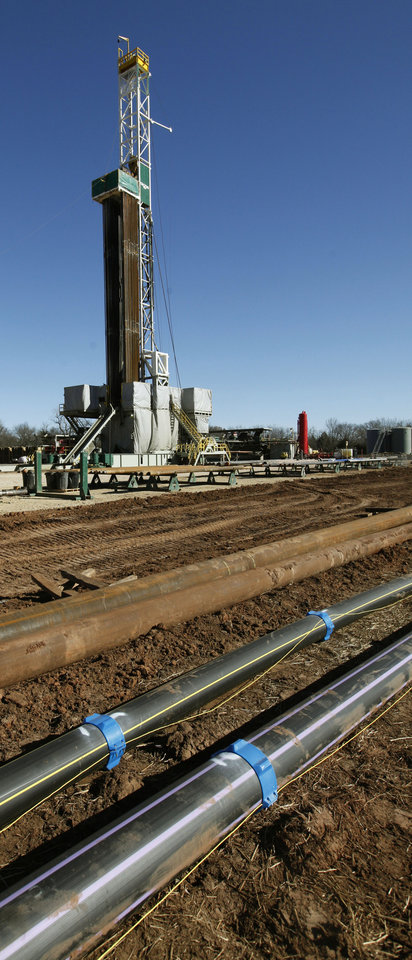 Several water pipelines run to and from this Devon Energy drilling rig a few miles east of Perry. Photo by Paul Hellstern, The Oklahoman