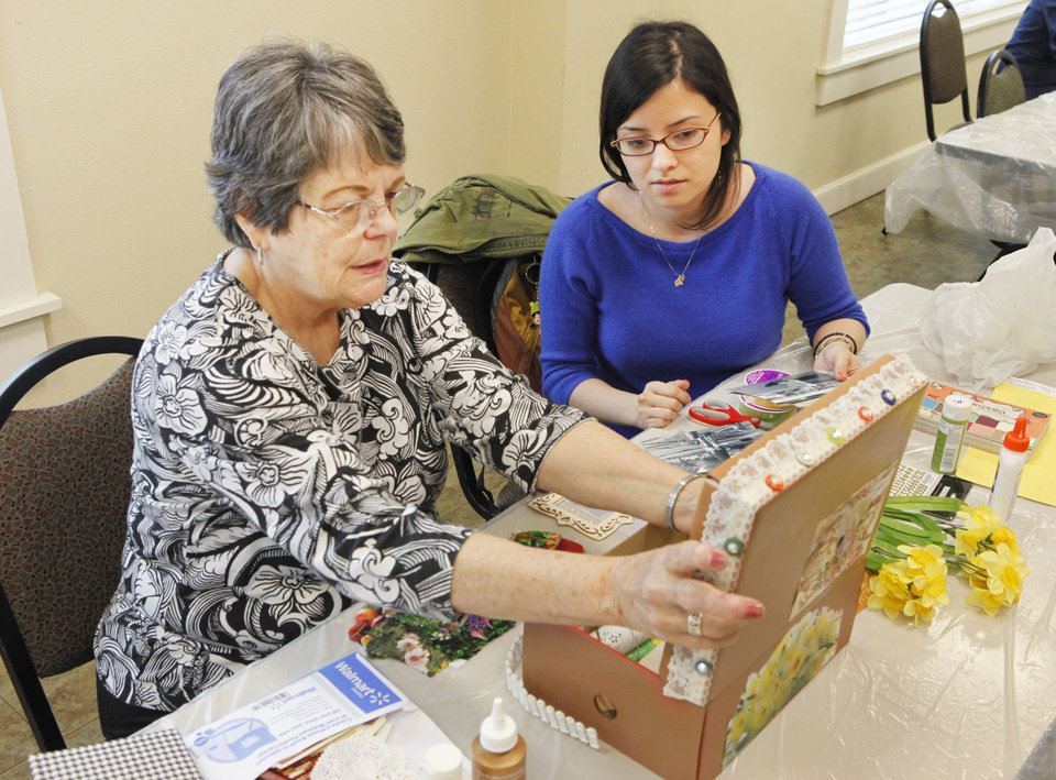 Sharon Groat and University of Central Oklahoma senior Michelle Tijerina work on the Intergenerational Story Box art project at the Edmond Senior Center on Wednesday. Photos By David McDaniel, The Oklahoman