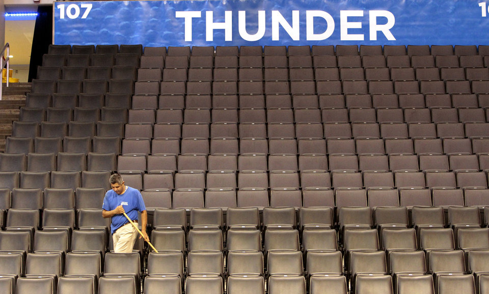 Gerardo Basquiec mops between seats in preparation for the first game of the NBA basketball finals at the Chesapeake Arena on Tuesday, June 12, 2012 in Oklahoma City, Okla.  Photo by Steve Sisney, The Oklahoman