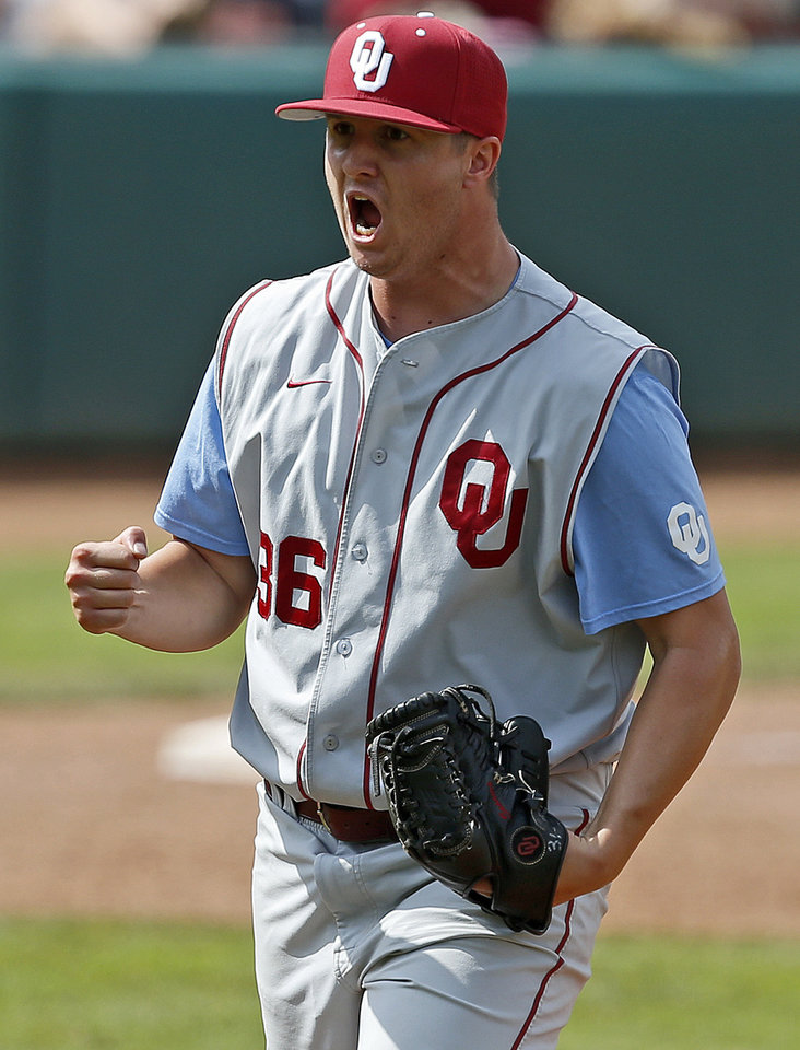 Photo - Oklahoma's Kyle Hayes reacts after defeating Kansas State during a Big 12 Championship tournament game at the Chickasaw Bricktown Ballpark in Oklahoma City, Saturday, May, 25, 2013. Oklahoma won 7-6. Photo by Bryan Terry, The Oklahoman