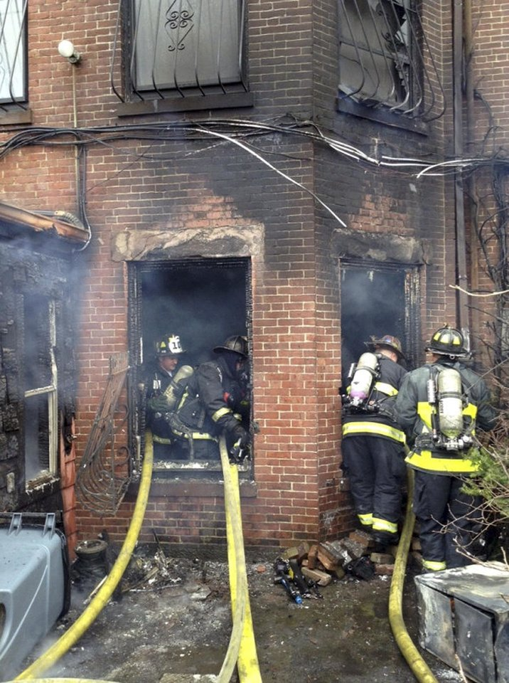 Photo - In this photo released by the Boston Fire Department via Twitter, firefighters battle a multi-alarm fire at a four-story brownstone in the Back Bay neighborhood near the Charles River Wednesday, March 26, 2014 in Boston.  (AP Photo/Boston Fire Department)