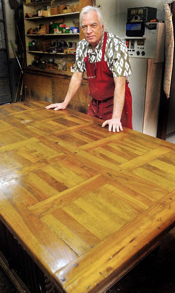 Richard Thomas, master furniture refinisher, with a 1750 French door used as a breakfast table in the Governor's Mansion. PHOTO PROVIDED  <strong>PROVIDED</strong>