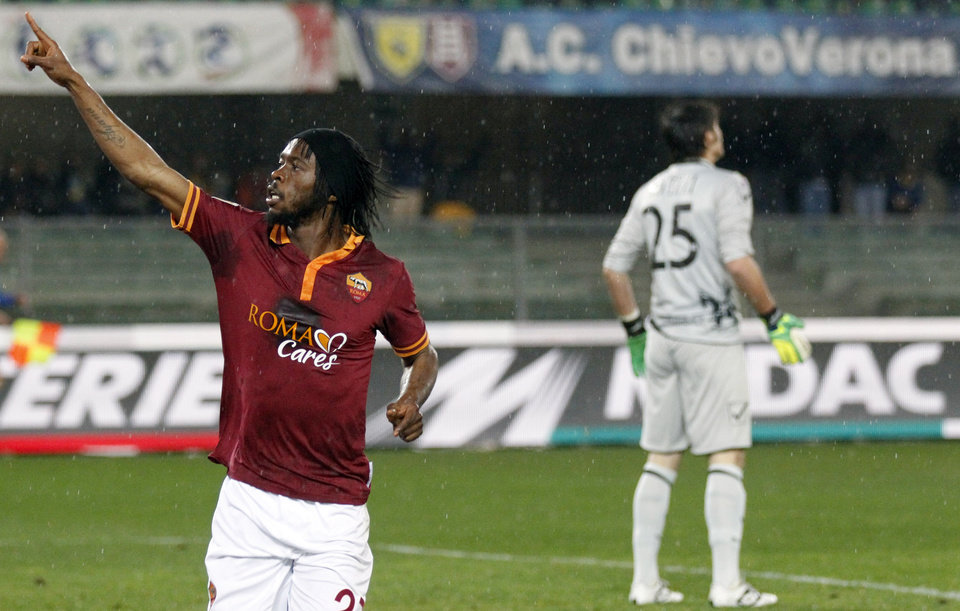 Photo - AS Roma's forward Gervinho, of Ivory Coast, celebrates after scoring during a Serie A soccer match against Chievo at Bentegodi stadium in Verona, Italy, Saturday, March 22, 2014. (AP Photo/Felice Calabro')