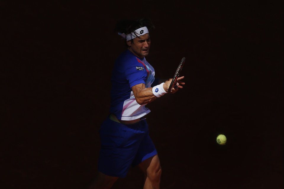 Photo - David Ferrer from Spain returns the ball during a Madrid Open tennis tournament match against Albert Ramos from Spain, in Madrid, Spain, Tuesday, May 6, 2014. (AP Photo/Andres Kudacki)