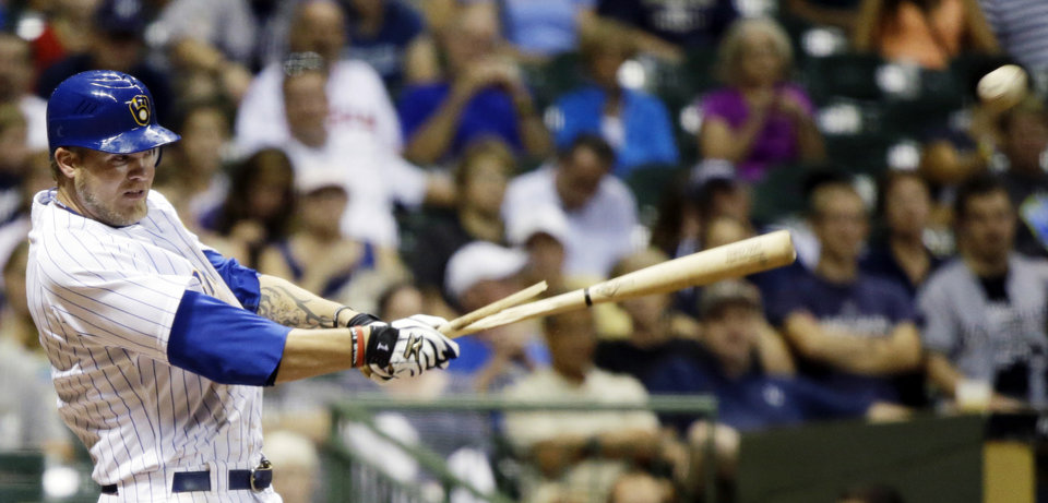 Photo -   Milwaukee Brewers' Corey Hart breaks his bat as he hits a single during the sixth inning of a baseball game against the Pittsburgh Pirates Friday, Aug. 31, 2012, in Milwaukee. (AP Photo/Morry Gash)