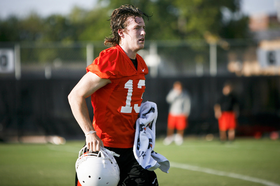 OSU COLLEGE FOOTBALL: Punter/kicker Quinn Sharp (13) jogs onto the field during OSU's first practice of the season on the campus of Oklahoma State University in Stillwater, Okla. on Friday, August 5, 2011. Photo by Zach Gray ORG XMIT: KOD