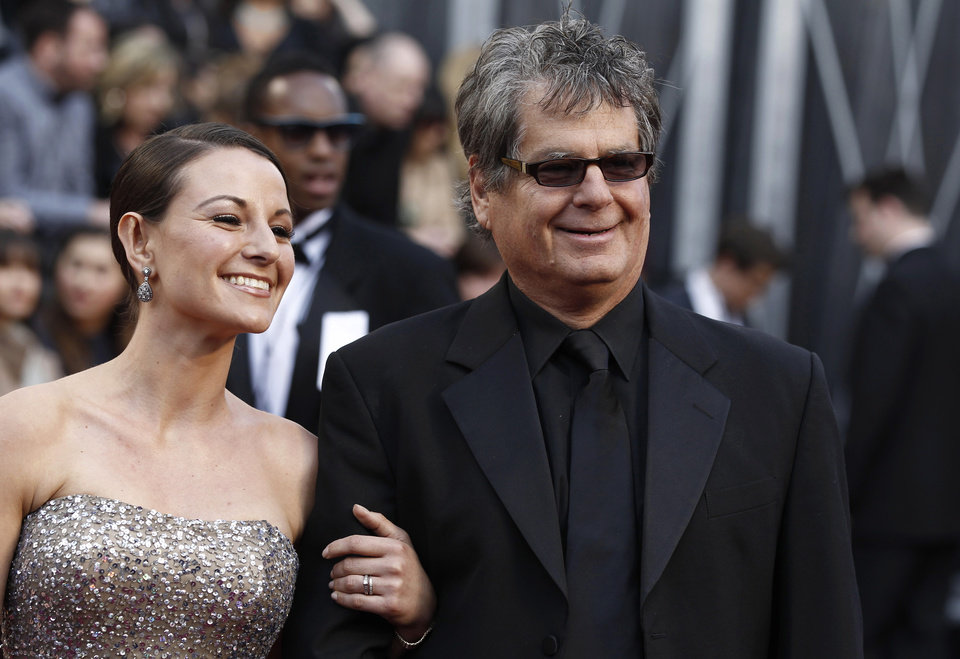 Robert Gould and unidentified guest arrive at the 84th Academy Awards on Sunday, Feb. 26, 2012, in the Hollywood section of Los Angeles. (AP Photo/Matt Sayles) ORG XMIT: OSC103