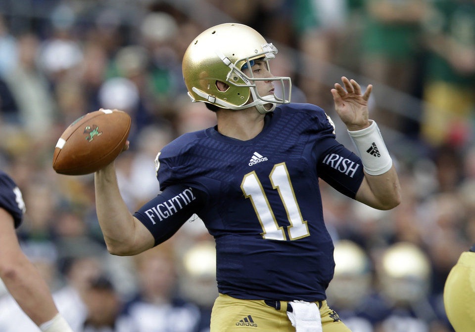 Notre Dame quarterback Tommy Rees throws against Michigan State during the first half of an NCAA college football game in South Bend, Ind., Saturday, Sept. 21, 2013. (AP Photo/Michael Conroy) ORG XMIT: INMC111