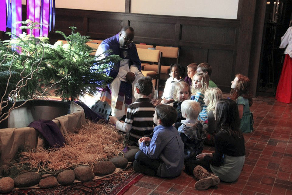 The Rev. Joseph Alsay talks to young people during a recent children's  lesson time at St. Augustine of Canterbury Episcopal Church where he is rector. Photo provided <strong></strong>