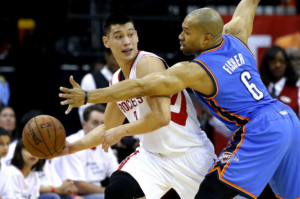 Oklahoma City's Derek Fisher defends Houston's Jeremy Lin during Game 3 in the first round of the NBA playoffs between the Oklahoma City Thunder and the Houston Rockets at the Toyota Center in Houston, Texas, Sat., April 27, 2013. Photo by Bryan Terry, The Oklahoman